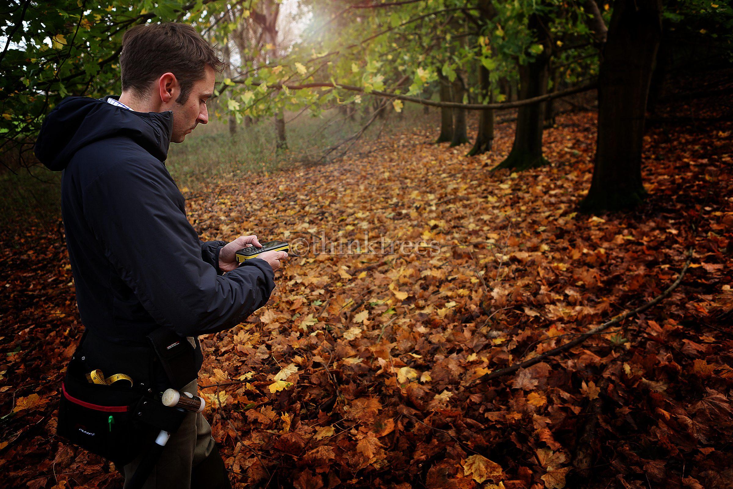 Tree surveyor measuring Tree dimensions using a leica disto d8 laser measure